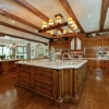 The gourmet kitchen Has A large center island walk In pantry with refrigerator And Eat In breakfast area