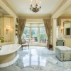 The master bathroom Is truly stunning with Its marble floors And Bay window